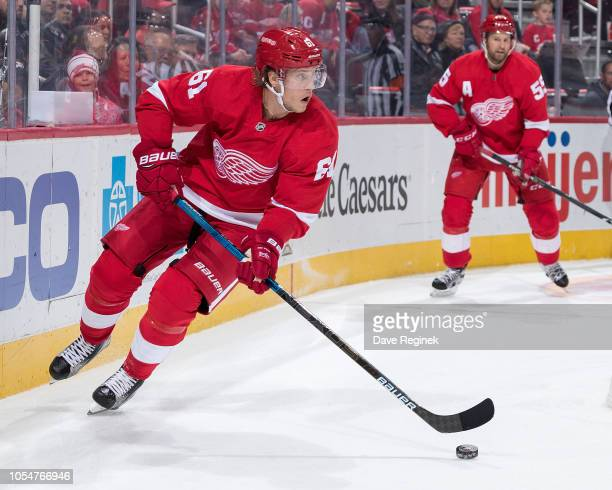 Jacob de la Rose of the Detroit Red Wings skates along the boards behind the net with the puck during an NHL game against the Dallas Stars at Little...