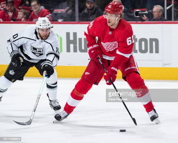 Jacob De La Rose of the Detroit Red Wings skates with the puck followed by Michael Amadio of the Los Angeles Kings during an NHL game at Little...