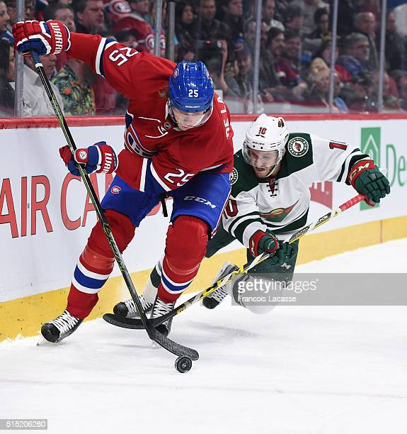 Jacob De La Rose of the Montreal Canadiens controls the puck against Jordan Schroeder the Minnesota Wild in the NHL game at the Bell Centre on March...