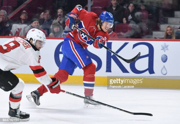 Jacob De La Rose of the Montreal Canadiens fires a shot against the New Jersey Devils in the NHL game at the Bell Centre on April 1 2018 in Montreal...
