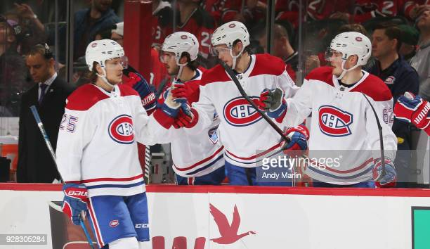 Jacob De La Rose of the Montreal Canadiens is congratulated after scoring a goal during the game against the New Jersey Devils at Prudential Center...