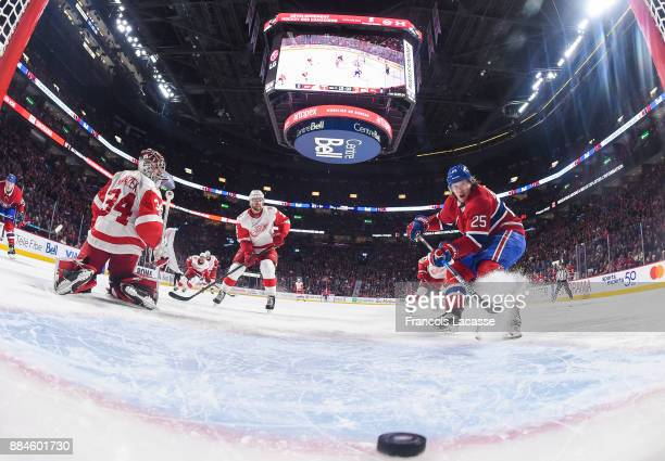Jacob De La Rose of the Montreal Canadiens scores a goal on goaltender Petr Mrazek the Detroit Red Wings in the NHL game at the Bell Centre on...