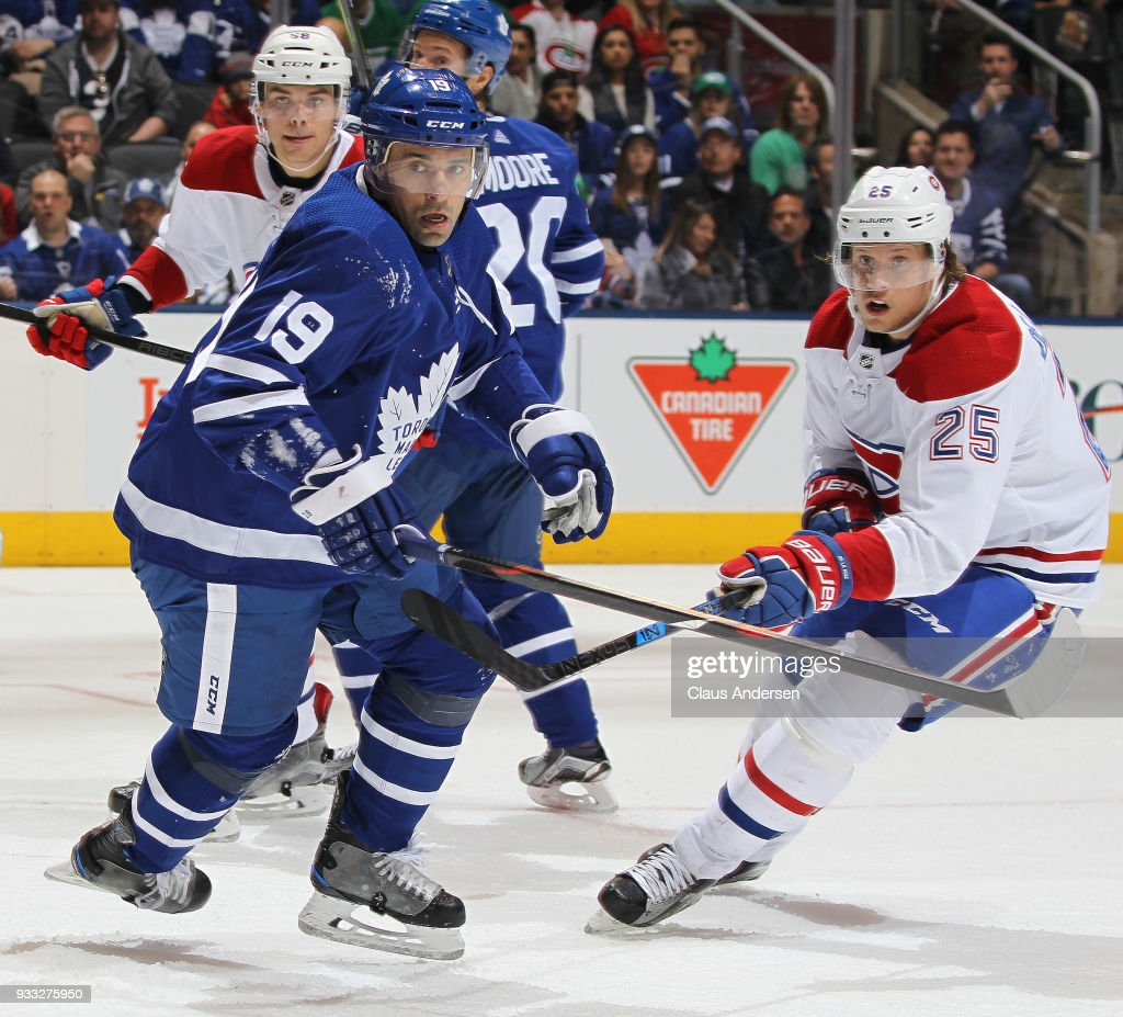 Jacob de la Rose #25 of the Montreal Canadiens skates against Tomas Plekanec #19 of the Toronto Maple Leafs during an NHL game at the Air Canada Centre on March 17, 2018 in Toronto, Ontario, Canada. The Maple Leafs defeated the Canadiens 4-0.