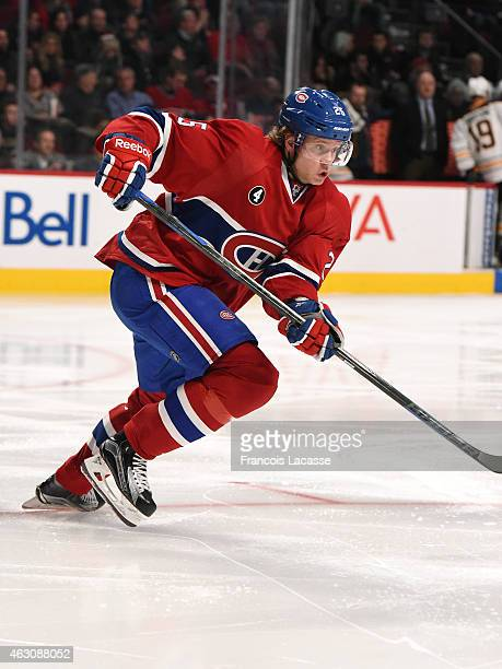 Jacob De La Rose of the Montreal Canadiens skates for the puck against the Buffalo Sabres in the NHL game at the Bell Centre on February 3 2015 in...