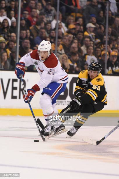 Jacob de la Rose of the Montreal Canadiens skates with the puck against Tim Schaller of the Boston Bruins at the TD Garden on January 17 2018 in...