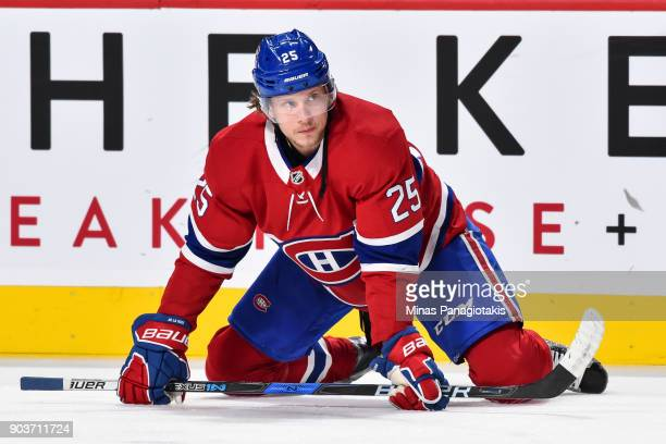 Jacob de la Rose of the Montreal Canadiens stretches during the warmup prior to the NHL game against the Vancouver Canucks at the Bell Centre on...