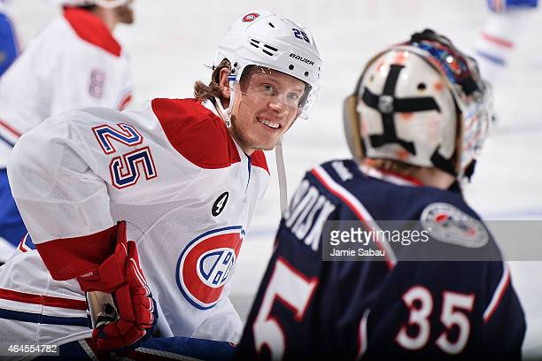 Jacob De La Rose of the Montreal Canadiens talks with goaltender Oscar Dansk of the Columbus Blue Jackets during warmups prior to a game on February...