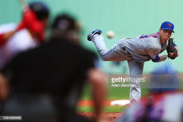 Jacob deGrom of the New York Mets pitches in the first inning of a game against the Boston Red Sox at Fenway Park on September 16 2018 in Boston...