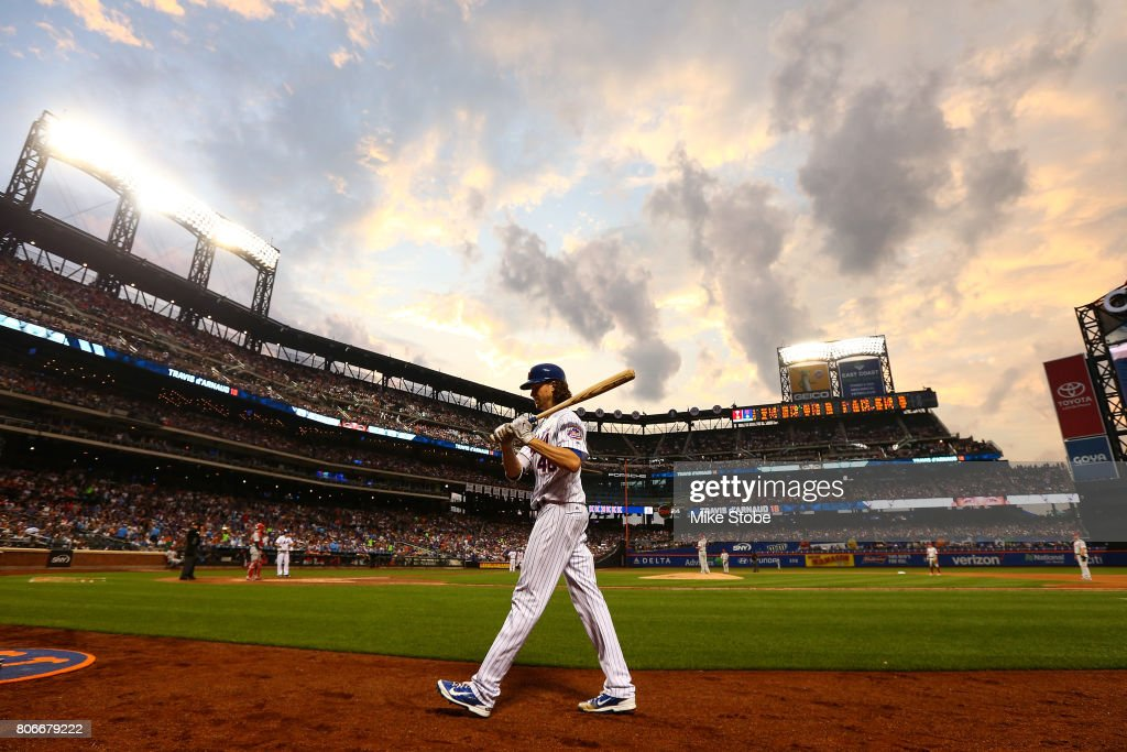 Jacob deGrom #48 of the New York Mets pitches iwalks to the batting circle against the Philadelphia Phillies at Citi Field on June 30, 2017 in the Flushing neighborhood of the Queens borough of New York City. New York Mets defeated the Philadelphia Phillies 2-1.