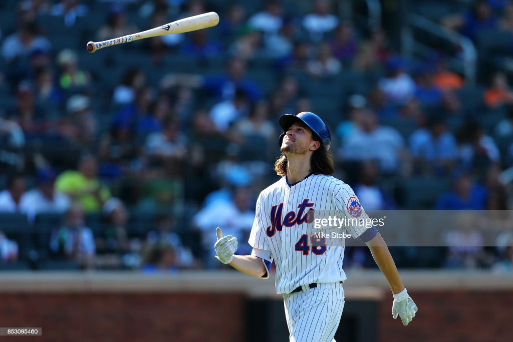 Jacob deGrom #48 of the New York Mets reacts after fouling out to third base in the fifth inning against the Washington Nationals at Citi Field on September 24, 2017 in New York City.