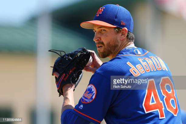 Jacob deGrom of the New York Mets warms up in the bullpen before a spring training baseball game against the Miami Marlins at Roger Dean Stadium on...