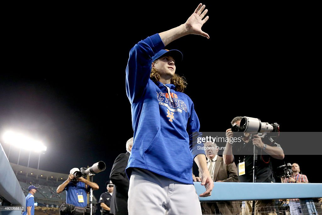 Jacob deGrom #48 of the New York Mets waves to fans as he leaves the field after the Mets 3-1 win against the Los Angeles Dodgers in game one of the National League Division Series at Dodger Stadium on October 9, 2015 in Los Angeles, California.