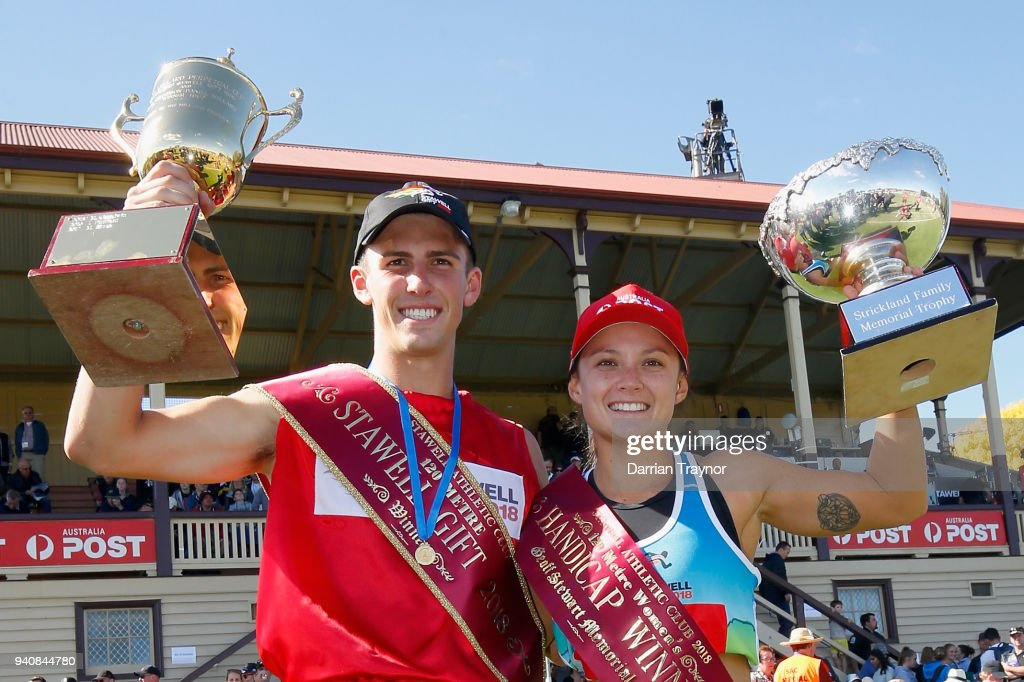 Jacob Despard and Elizabeth Forsyth pose with the the winners trophies after Stawell Gift on April 2, 2018 in Stawell, Australia.