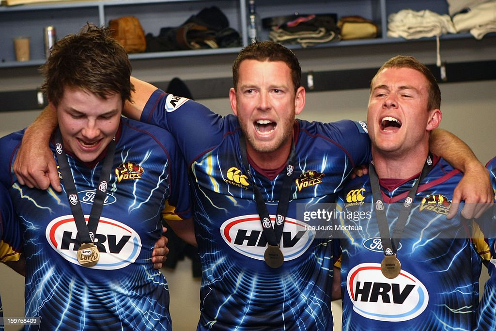 Jacob Duffy (L), Ian Butler (C) and Nick Beard (R) of Otago celebrate after winning the HRV T20 Final match between the Otago Volts and the Wellington Firebirds at University Oval on January 20, 2013 in Dunedin, New Zealand.