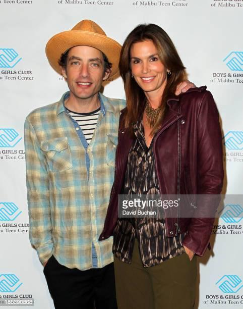 Jacob Dylan and Cindy Crawford attend Malibu Boys And Girls Club Gala on October 19 2013 in Malibu California