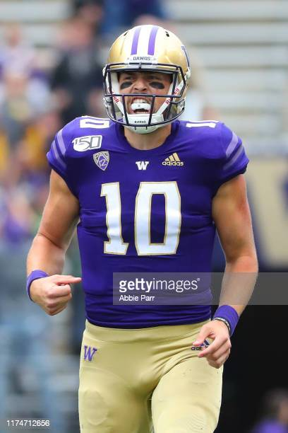 Jacob Eason of the Washington Huskies celebrates after throwing a 28 yard touchdown against the Hawaii Rainbow Warriors in the first quarter during...
