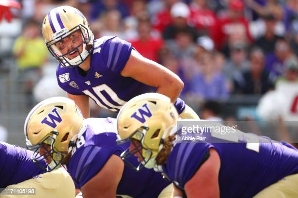 Jacob Eason of the Washington Huskies looks down the field in the fourth quarter against the Eastern Washington Eagles during their game at Husky...