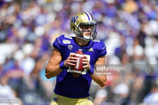 Jacob Eason of the Washington Huskies looks for an open receiver during the first game of the season against the Eastern Washington Eagles at Husky...