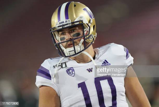 Jacob Eason of the Washington Huskies looks on during warm ups prior to the start of an NCAA football game against the Stanford Cardinal at Stanford...