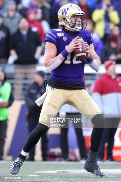 Jacob Eason of the Washington Huskies looks to rt the ball against the Washington State Cougars in the first quarter during their game at Husky...