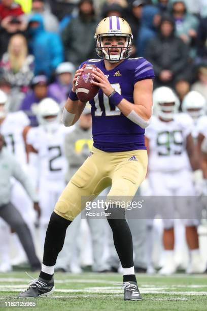 Jacob Eason of the Washington Huskies looks to throw the ball against the Oregon Ducks in the second quarter during their game at Husky Stadium on...
