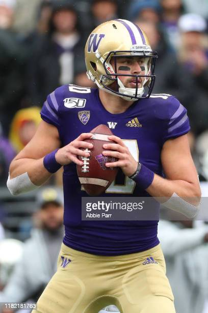 Jacob Eason of the Washington Huskies looks to throw the ball against the Oregon Ducks in the first quarter during their game at Husky Stadium on...