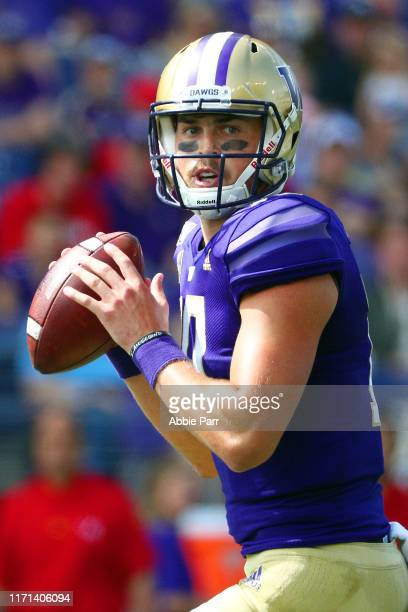 Jacob Eason of the Washington Huskies looks to throw the ball in the first quarter against the Eastern Washington Eagles during their game at Husky...