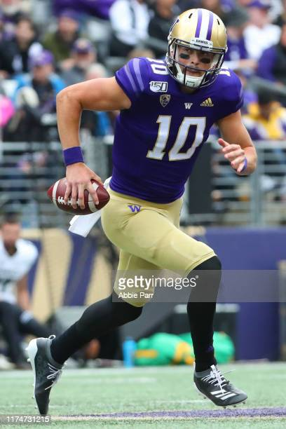 Jacob Eason of the Washington Huskies runs with the ball against the Hawaii Rainbow Warriors in the first quarter during their game at Husky Stadium...