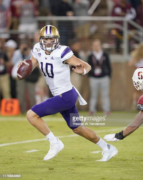 Jacob Eason of the Washington Huskies scramble away from the pressure against the Stanford Cardinal during the second quarter of an NCAA football...