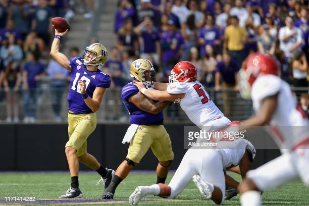 Jacob Eason of the Washington Huskies throws the ball deep during the first game of the season against the Eastern Washington Eagles at Husky Stadium...