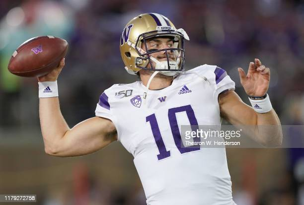 Jacob Eason of the Washington Huskies warms up prior to the start of an NCAA football game against the Stanford Cardinal at Stanford Stadium on...