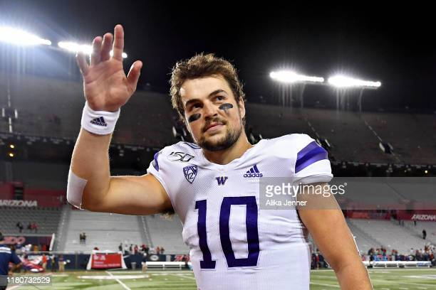 Jacob Eason of the Washington Huskies waves to fans as he leaves the field after the game against the Arizona Wildcats at Arizona Stadium on October...