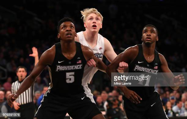 Jacob Epperson of the Creighton Bluejays competes for a rebound with Rodney Bullock and Alpha Diallo of the Providence Friars in overtime during the...
