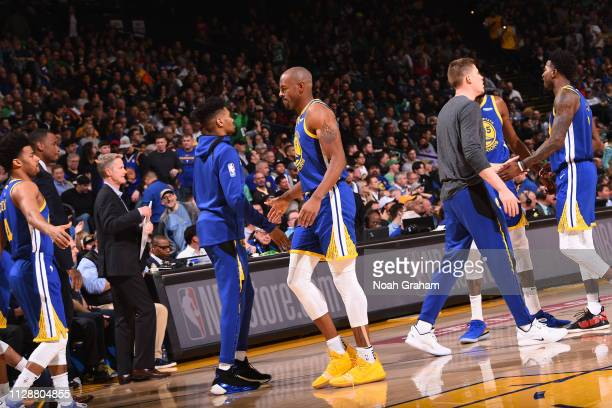 Jacob Evans hifives Andre Iguodala of the Golden State Warriors on March 5 2019 at ORACLE Arena in Oakland California NOTE TO USER User expressly...