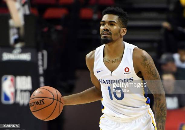 Jacob Evans III of the Golden State Warriors brings the ball up the court against the Los Angeles Clippers during the 2018 NBA Summer League at the...