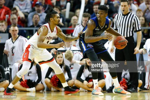 Jacob Evans of the Cincinnati Bearcats defends Junior Etou of the Tulsa Golden Hurricane at BBT Arena on February 25 2018 in Highland Heights Kentucky