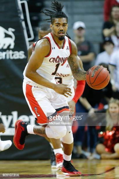 Jacob Evans of the Cincinnati Bearcats dribbles up the court against the Tulsa Golden Hurricane at BB&T Arena on February 25, 2018 in Highland...