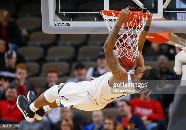 Jacob Evans of the Cincinnati Bearcats dunks the ball against the ArkansasPine Bluff Golden Lions at BBT Arena on December 19 2017 in Highland...