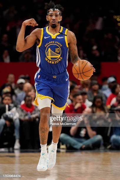 Jacob Evans of the Golden State Warriors dribbles against the Washington Wizards in the first half at Capital One Arena on February 03, 2020 in...