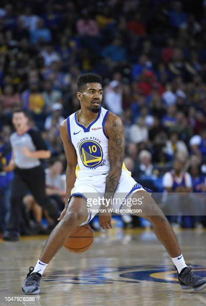 Jacob Evans of the Golden State Warriors dribbles the ball against the Minnesota Timberwolves during an NBA basketball game at ORACLE Arena on...