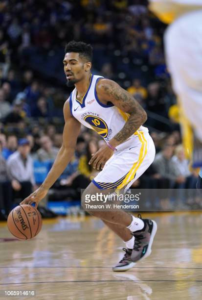 Jacob Evans of the Golden State Warriors dribbles the ball against the Memphis Grizzlies during an NBA basketball game at ORACLE Arena on November 5,...