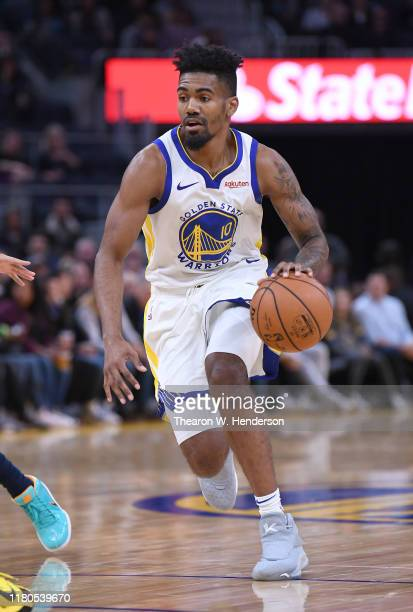 Jacob Evans of the Golden State Warriors dribbling the ball drives towards the basket against the Minnesota Timberwolves during an NBA basketball...