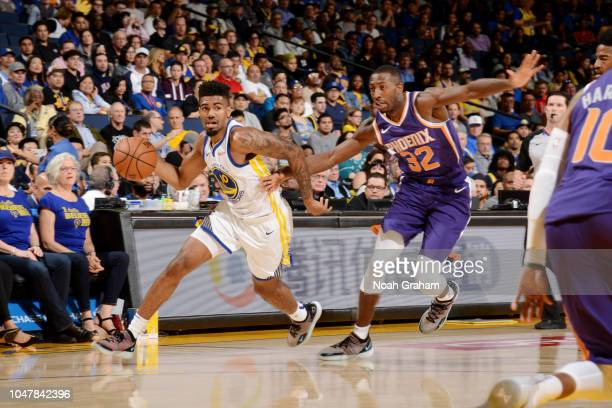 Jacob Evans of the Golden State Warriors handles the ball against the Phoenix Suns during a pre-season game on October 8, 2018 at ORACLE Arena in...