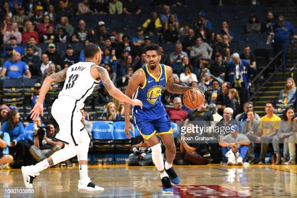 Jacob Evans of the Golden State Warriors handles the ball against the Brooklyn Nets on November 10, 2018 at ORACLE Arena in Oakland, California. NOTE...