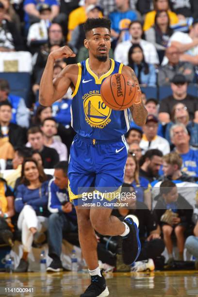 Jacob Evans of the Golden State Warriors handles the ball against the Dallas Mavericks on March 22, 2019 at ORACLE Arena in Oakland, California. NOTE...