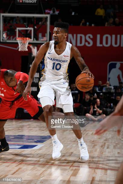 Jacob Evans of the Golden State Warriors handles the ball against the Toronto Raptors during Day 2 of the 2019 Las Vegas Summer League on July 6,...