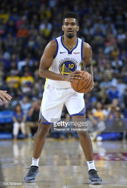 Jacob Evans of the Golden State Warriors looks to pass the ball against the Minnesota Timberwolves during an NBA basketball game at ORACLE Arena on...