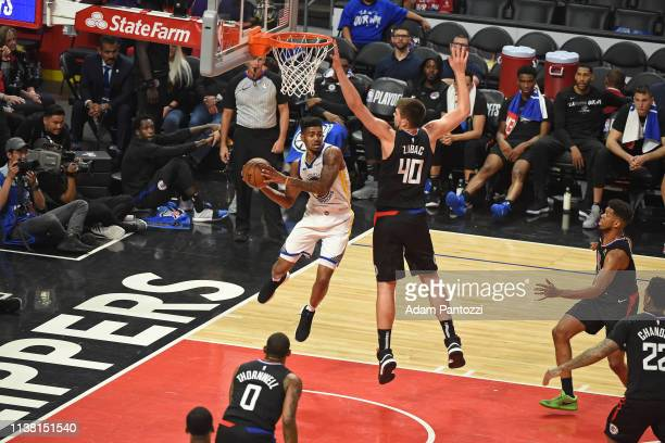 Jacob Evans of the Golden State Warriors looks to passes the ball against the LA Clippers during Game Three of Round One of the 2019 NBA Playoffs on...