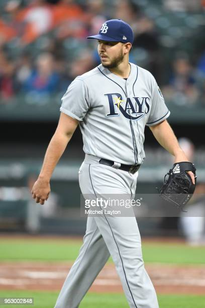 Jacob Faria of the Tampa Bay Rays walks back to the dug out during a baseball game against the Baltimore Orioles at Oriole Park at Camden Yards on...