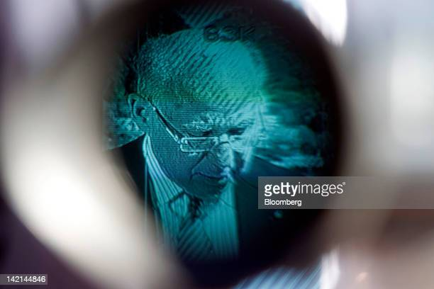 Jacob Frenkel, chairman of JPMorgan Chase International, is seen through a video camera as he pauses during a television interview at the Ambrosetti...
